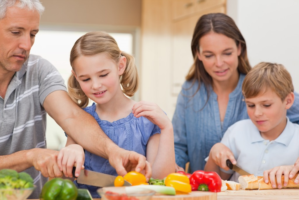 Lovely family cooking together at home